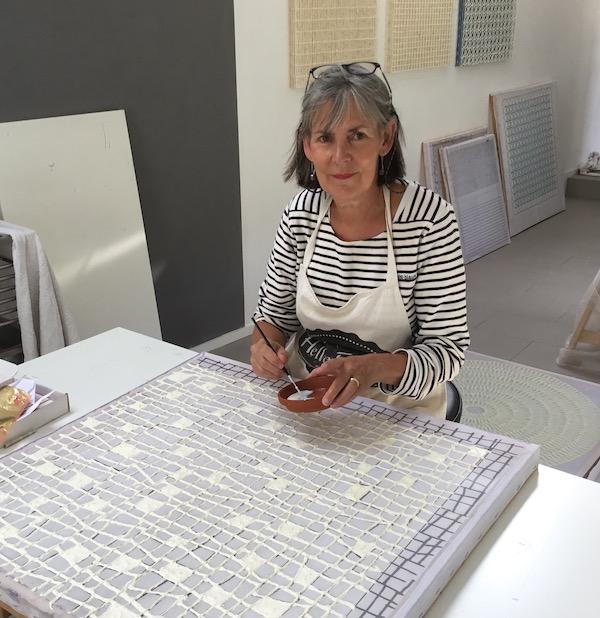 Paper artist Gill Wilson at work in her studio